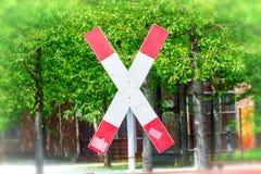 Kors för St Andrew ` s på en järnvägkorsning royaltyfria foton