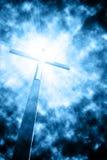 Kors i solstrålar Arkivfoto