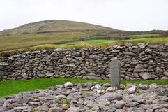 Kors i stenen Arkivfoto