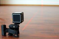 Kors-linje laser Arkivfoton