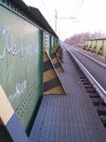 Korsa en järnvägsbro - soluppgång i diket Burlamacca Royaltyfri Bild