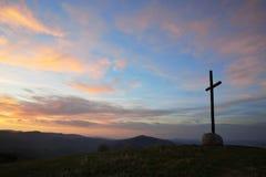 Korsa på skybakgrund royaltyfria bilder