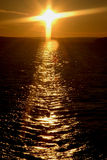 korsa solnedgången Royaltyfri Foto
