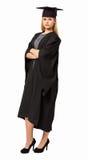 Korsade armar för studentIn Graduation Gown anseende Royaltyfri Bild