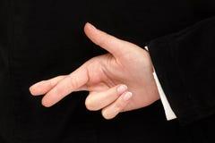 korsade fingrar Royaltyfri Fotografi