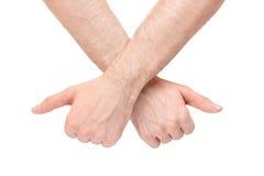 Korsade händer som ger upp tummar Royaltyfri Foto