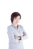 Korsar det asiatiska kvinnaanseendet för affär och hennes arm Arkivfoton