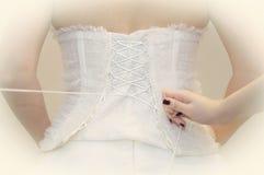 korsettera klänningbröllop Arkivbilder