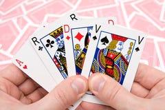 kort fyra händer som rymmer att leka Royaltyfri Foto