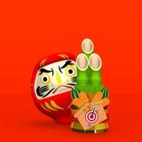 Kort Kadomatsu och Daruma docka på rött textutrymme royaltyfri illustrationer