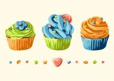 Kort med färgrika muffin och garneringar Ställ in med bakelser Fotografering för Bildbyråer