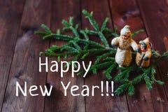 Kort nya Year& x27; s-leksaker Arkivfoto