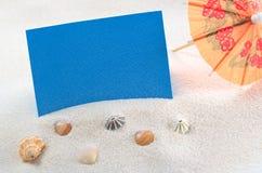 Kort på sand Arkivfoto