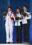 Korta spårdamers ceremoni för 1000m medalj Arkivbild