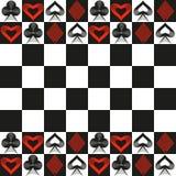 Kortdräkter och bakgrund för schackbräde Royaltyfri Fotografi