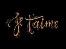 Kortet för Je t `-aime med guld- blänker effekt fransmannen älskar jag dig Modern borstekalligrafi Lyckligt uttryck för dag för v Fotografering för Bildbyråer