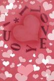 kortet fyllda hjärtor älskar jag dig Arkivfoto