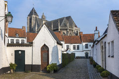 Kortrijk Beguinage and the Notre Dame Church nearby. Stock Image
