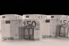 kortslutning för pengar för fält för bakgrundsdjupeuro Arkivfoto