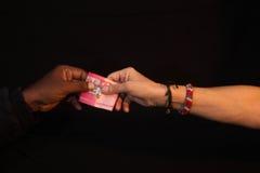 Korupcja gest korupcja z pieniądze ręka Zdjęcia Stock