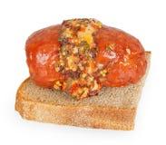 Korv på bröd med kryddor Royaltyfria Bilder