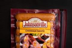 Korvar för Johnsonville cheddarost royaltyfri fotografi