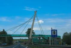 Glass pedestrian bridge over the road stock photo