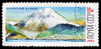 Koryakskaya Sopka volcano (3456 m), Volcanoes of Kamchatka serie, circa 1965. MOSCOW, RUSSIA - FEBRUARY 20, 2019: A stamp printed in USSR (Russia) shows stock photography