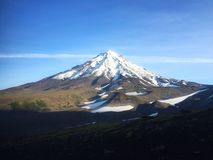 View of the Koryaksky volcano frome the slope of the Avachinsky volcano. royalty free stock photo