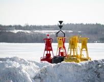 Korytkowy markier Bouys przechujący na brzeg zimie Fotografia Stock