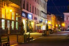 Korzo street in evening. Uzhgorod, Ukraine - OCT 25, 2014: Korzo street in evening. main street of the old town. popular tourist destination and meeting place stock photo