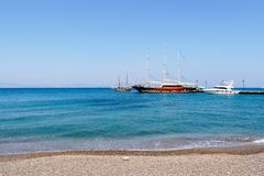 Kos island beach and ship in Greece stock photography