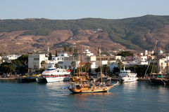 Kos town  - Tipical wooden daily boat trip arrives at dusk in harbor Royalty Free Stock Photo