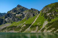 Koscielec mountain over the Black Pond Stock Image
