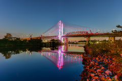 Kosciuszko Bridge - New York City. New and old Kosciuszko bridges joining Brooklyn and Queens in New York City across Newtown Creek. The new bridge is a cable Royalty Free Stock Images
