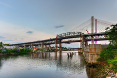 Kosciuszko Bridge - New York City. New and old Kosciuszko bridges joining Brooklyn and Queens in New York City across Newtown Creek. The new bridge is a cable Stock Photo