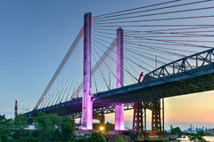 Kosciuszko Bridge - New York City. New and old Kosciuszko bridges joining Brooklyn and Queens in New York City across Newtown Creek. The new bridge is a cable Stock Images