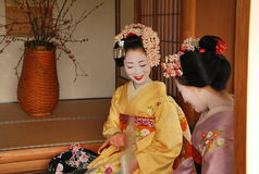 Kosen and Mamechiho Geishas seat in japanese room Stock Images