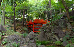 Koshikawa Korakuen red bridge. Beautiful wood bridge in a traditional japanese garden Stock Images
