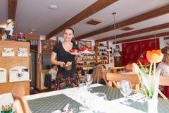 Kosice, Slovakia - April 17, 2018: the waiter at the cafe serves food. stock photos