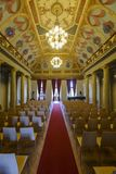 East Slovak Gallery in Kosice. Kosice, Slovakia - August 12, 2018: Assembly hall, the so-called historic hall, with illusive arcades showing the coat of arms of royalty free stock photo