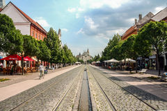 KOSICE, SLOVAKIA - JUNE 12, 2014: Kosice Main Street hlavna with pedestrians and bicylces passing by. Stock Images