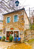 In Kosmas village in Greece. Beautiful old buildings around he pictorial square of Kosmas village in southern Peloponnese in Greece Stock Image