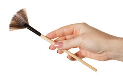 Kosmetische Bürste in der Hand Lizenzfreie Stockfotos