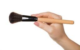 Kosmetische Bürste in der Hand Lizenzfreies Stockfoto