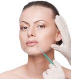 Kosmetische botoxinjectie in het schoonheidsgezicht stock afbeeldingen