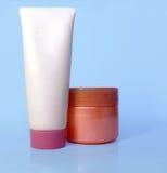 Kosmetische buis en pot van room Stock Fotografie