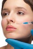 Kosmetische injectie van botox Stock Afbeeldingen