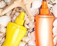 Kosmetische Lichtschutzprodukte für Strandferien Lizenzfreies Stockfoto