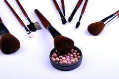 Kosmetische poeder en borstels Stock Fotografie